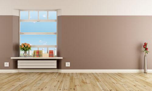 Ảnh chụp nội thất hiện đại với bộ tản nhiệt dưới cửa sổ